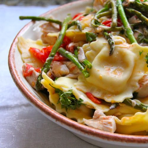 This super yummy recipe features chicken stock, rotisserie chicken, cheese ravioli, tomatoes, onions, garlic and asparagus.