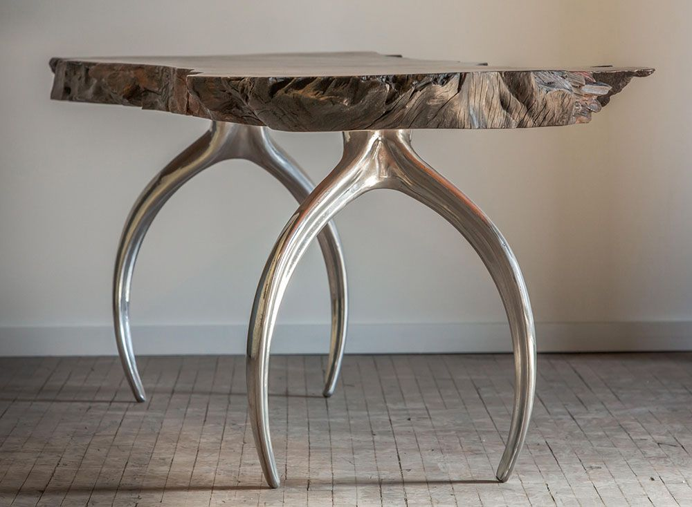 Mirror finish polished aluminum cast table legs paired with a wood