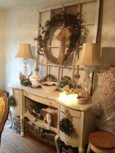 Repurposed dresser as a buffet... could put one of those electric fireplaces in the middle of this.