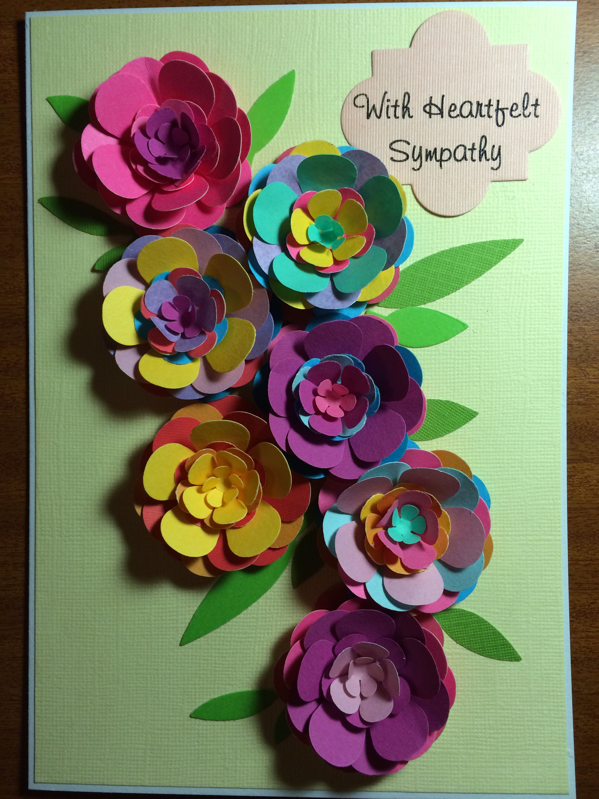 Handmade card. Punched flowers in multi-coloured paper.