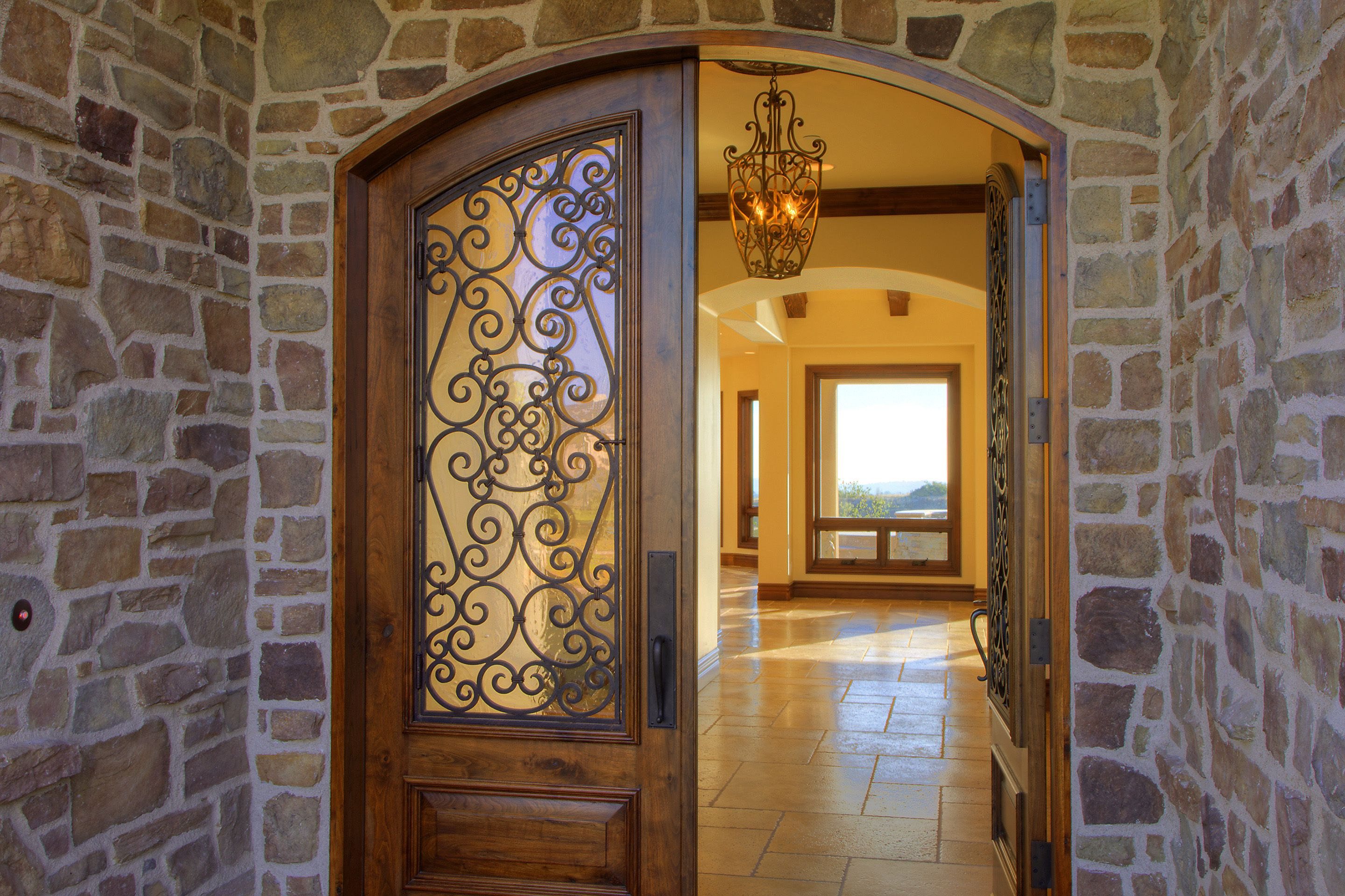 Solid Wood Double Front Entry Door With Window Based Top And Wrought Iron  Design.