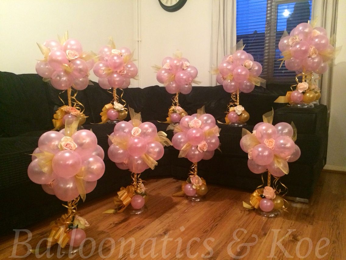 Pink and gold topiary balloon centre pieces wedding