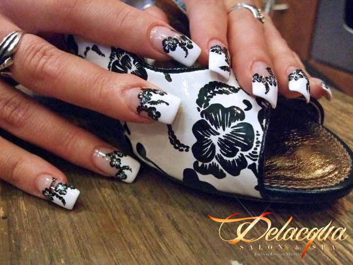 This awesome nail design was brought to you by our team at Delacqua Salon and Spa! Who wouldn't want to match their nails to their shoes? OPEN 7 DAYS A WEEK 9AM-8PM Call 718-266-1233 for your appointment today.