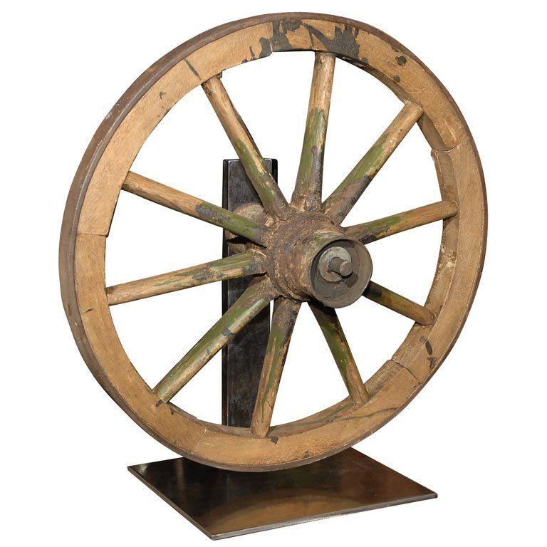 Antique Wagon Wheels Antique Wagon Wheel On Brushed Steel Stand Antique Wagon Wheels Wagon Wheel Antique Sculpture