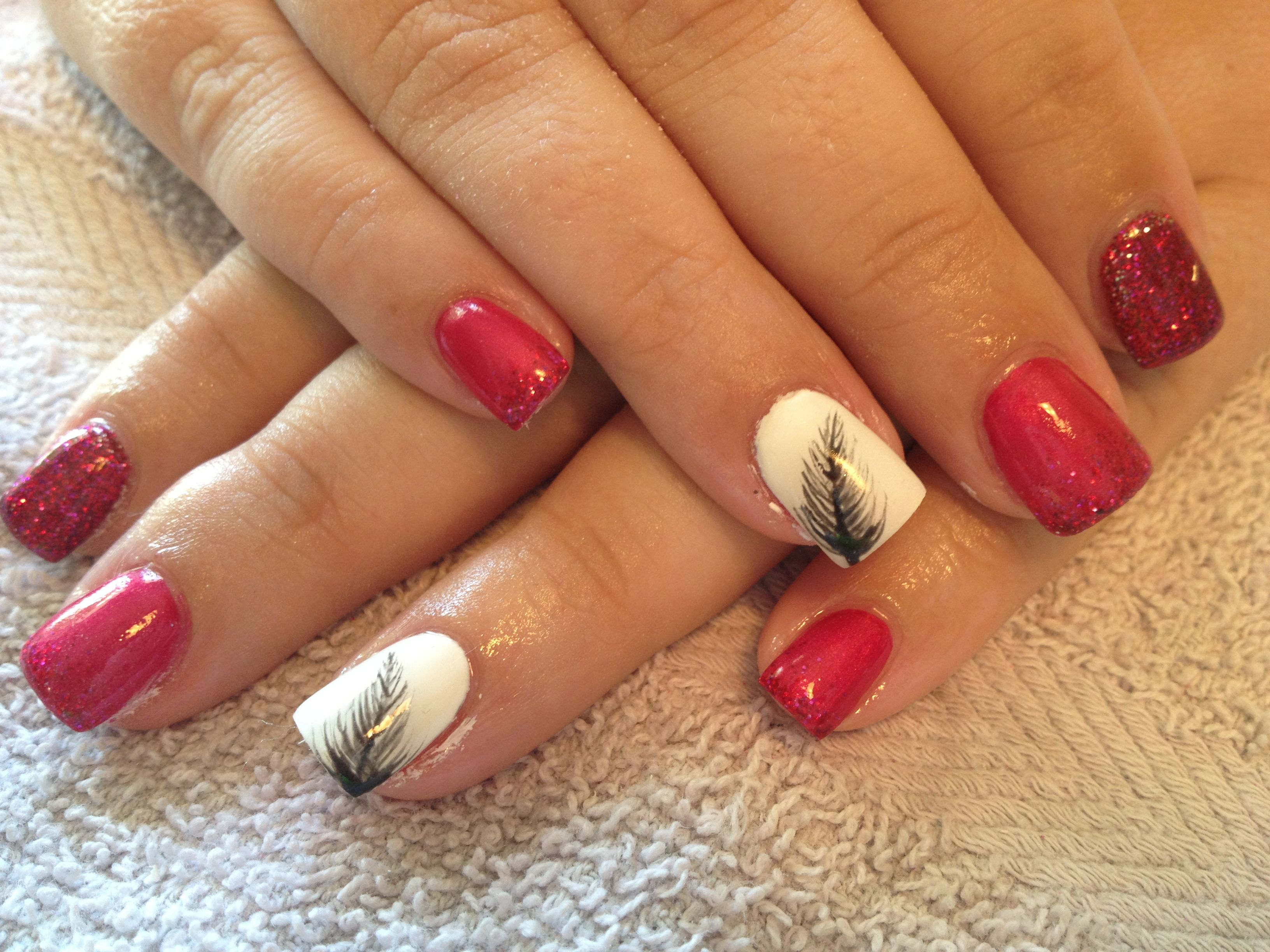 Fuscia nails with feather