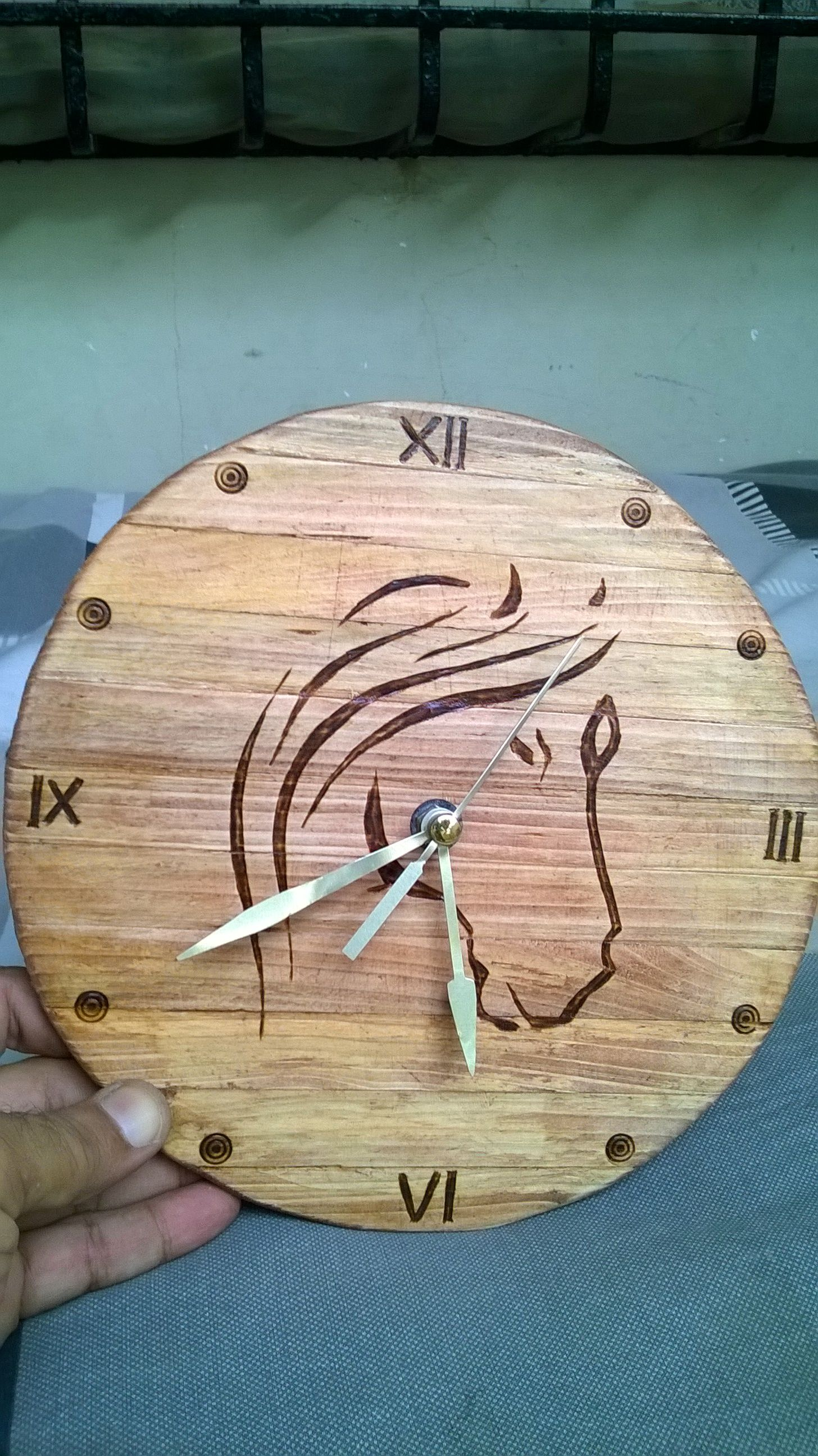 I have made wall clock with wood pieces & pyrography work