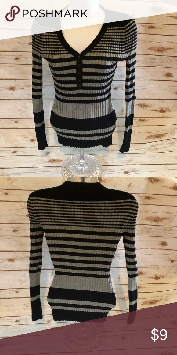 f9870b150f Rue 21 black and gray sweater Rue 21 black and gray sweater. This sweater  is form fitting and just like new. Size medium. Rue21 Sweaters V-Necks