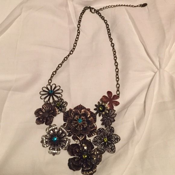 Charming Charlie Statement Necklace Bronze and silver adjustable metal flower necklace with green and blue gems. Great statement to any outfit! Never worn, in perfect condition. Charming Charlie Jewelry Necklaces