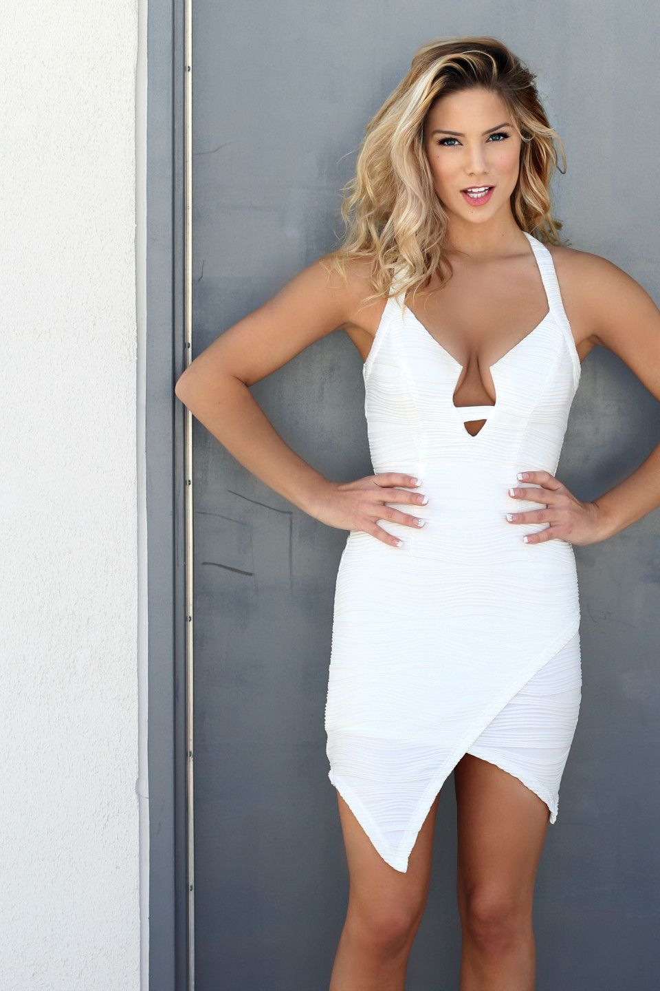 Spice up your wardrobe with this new white envelope skirt dress