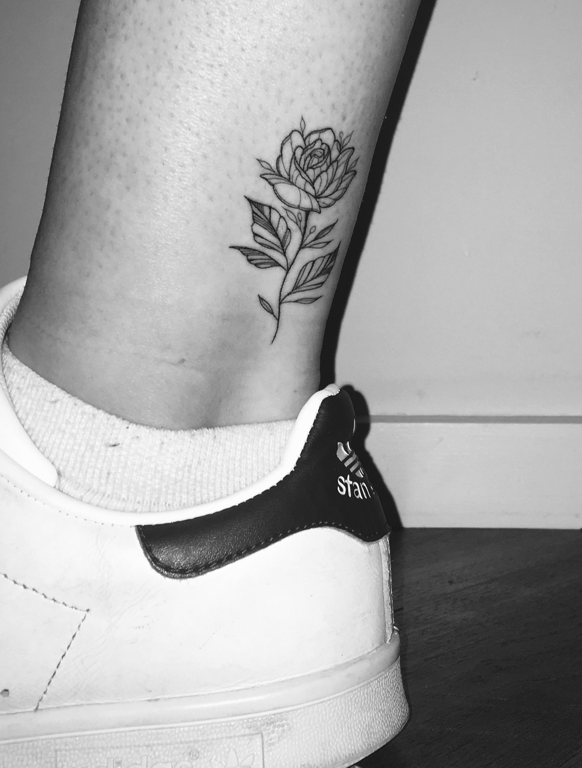Little Rose Single Needle Tattoo On The Back Of The Ankle By