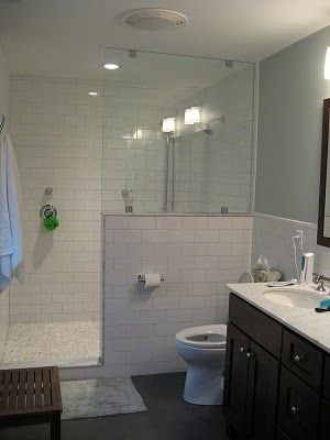 white subway tile bathroom with pebble flooring | what a