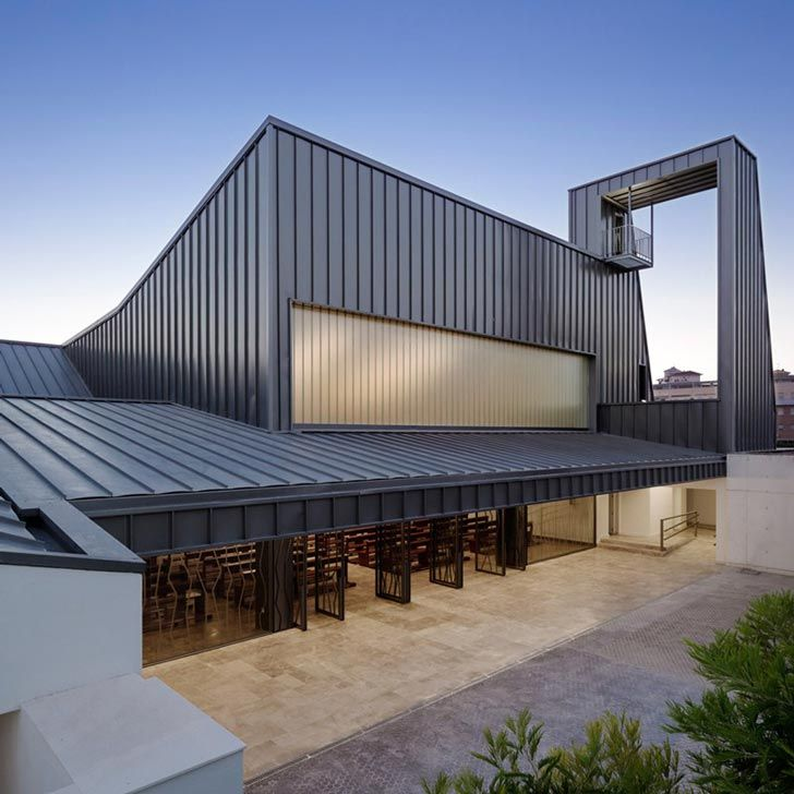 Modern industrial facade wraps agi architects 39 la for Modern industrial building design