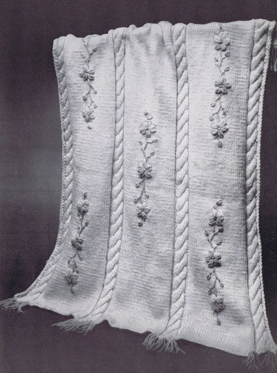 This one is knit with lazy-daisy flowers and leaves stitched on afterward.