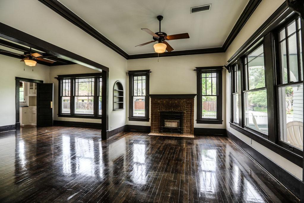 Hardwood floors, white walls, brown trim. Yes, THIS