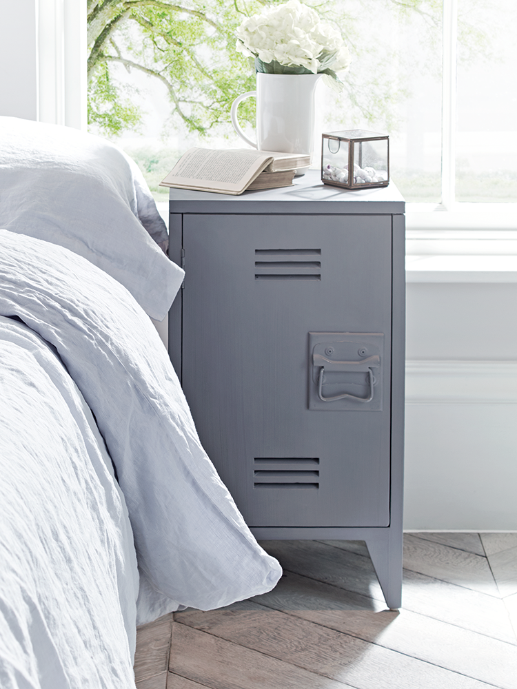 Inspired by vintage lockers, our pair of industrial style bedside tables  have been carved from mango wood with a soft grey painted finish.