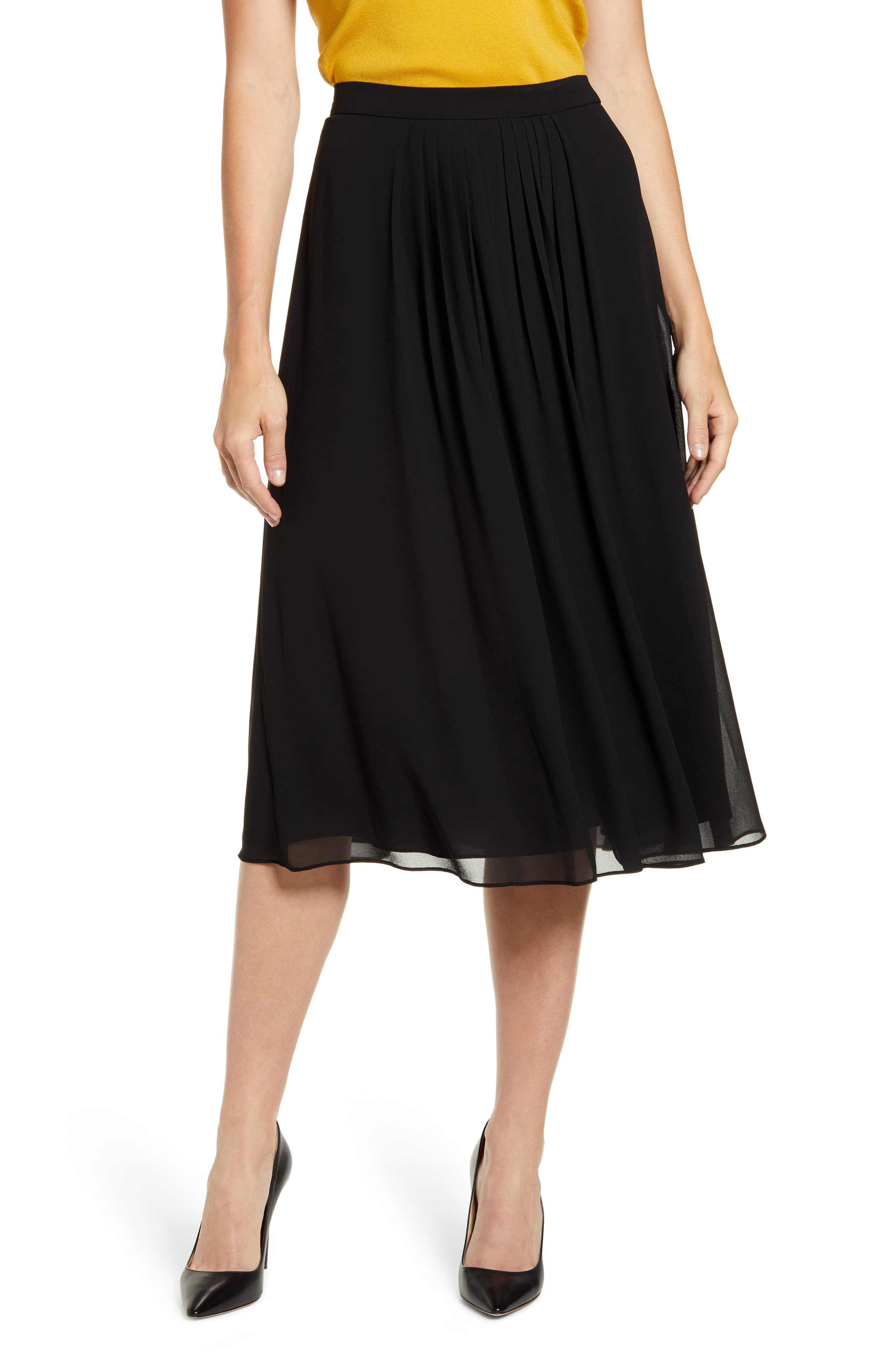 Crisp pleats at the waist create the flowing, dynamic profile of this gauzy A-line skirt. Style Name:Anne Klein Pleated A-Line Skirt. Style Number: 5881208. Available in stores.