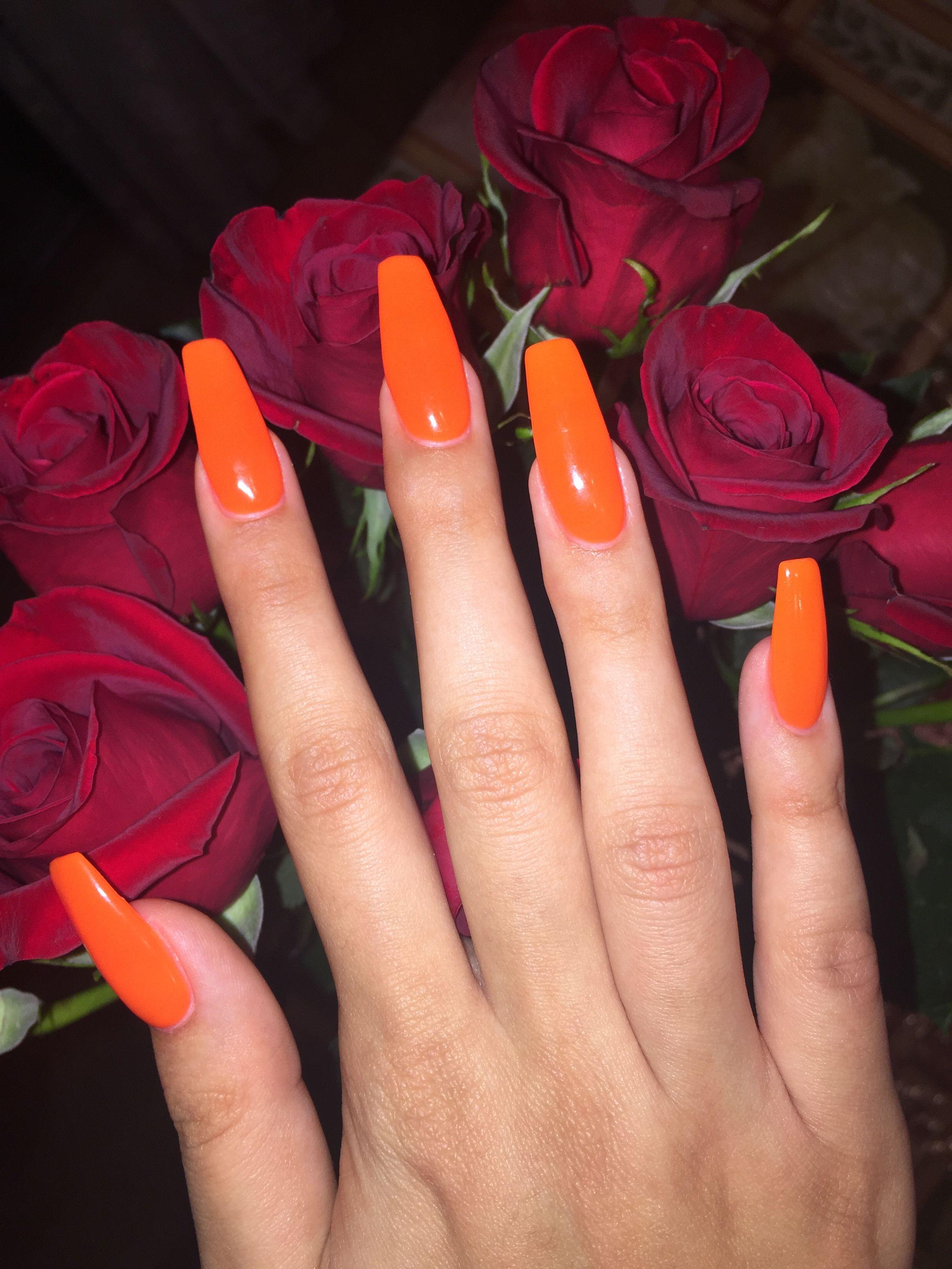 My long coffin bright orange nails