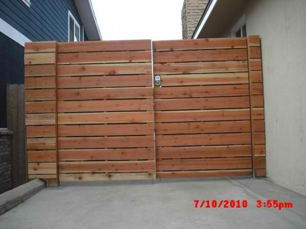 1x6 Redwood Modern Horizontal Privacy Driveway Gates With Electric Combo Deadbolt 5 Before Staining Marine Ave Manhattan Beach 90266 Driveway Gate Driveway Gate Diy Driveway