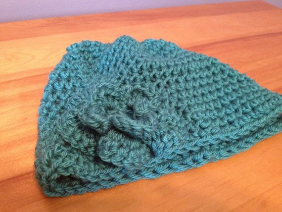 Teal beanie with flower embellishment