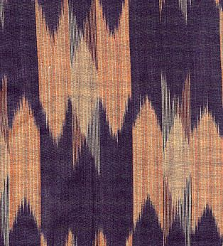 For warp ikats (as shown below), it's the warp threads that are bound and dyed. The fabric is woven with plain wefts, as all of the patterning is in the warps. The irregular, feathery design outlines are a characteristic feature, where the dye seeps under the bindings slightly. In contrast, vertical pattern lines are crisp and smooth.