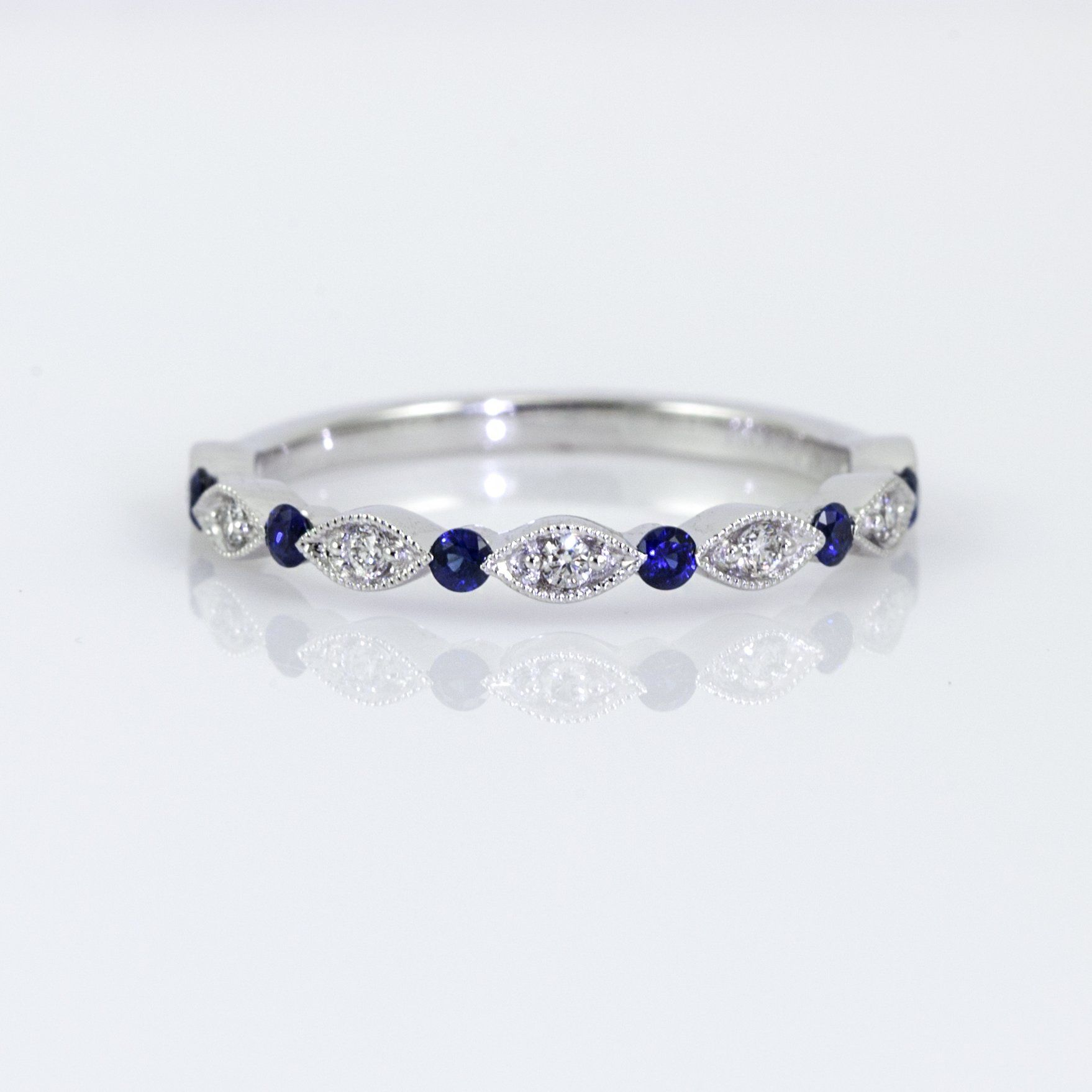 10936e224 14K white gold milgrain detail diamond and sapphire wedding band containing  7 round brilliant diamonds totaling 0.08ct (GH/SI1-2) and 6 sapphires  totaling ...
