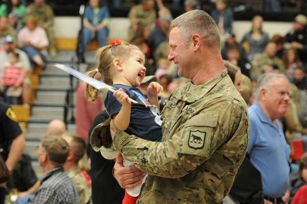 Staff Sgt. Jeff Wright, a Soldier with the 200th Engineer Company, South Dakota Army National Guard, shares a laugh with his niece, Lakyn, during the welcome home ceremony after completing a yearlong deployment to Afghanistan. #Homecoming