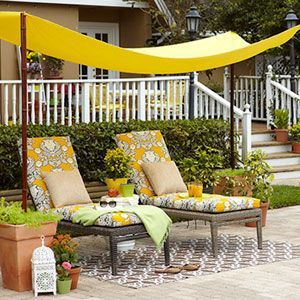 Backyard canopy.  Put PVC pipe into a   5-gallon bucket, then pour cement around it. Once dry,  put bucket into tall   planter, surround bucket w/ gravel, then top w/ soil. (Not covering pipe) Stick   bamboo pole into the pipe & hang fabric w/ ties through   grommets.
