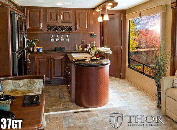 gas-powered luxury class a rv with island kitchen, bar, & wine