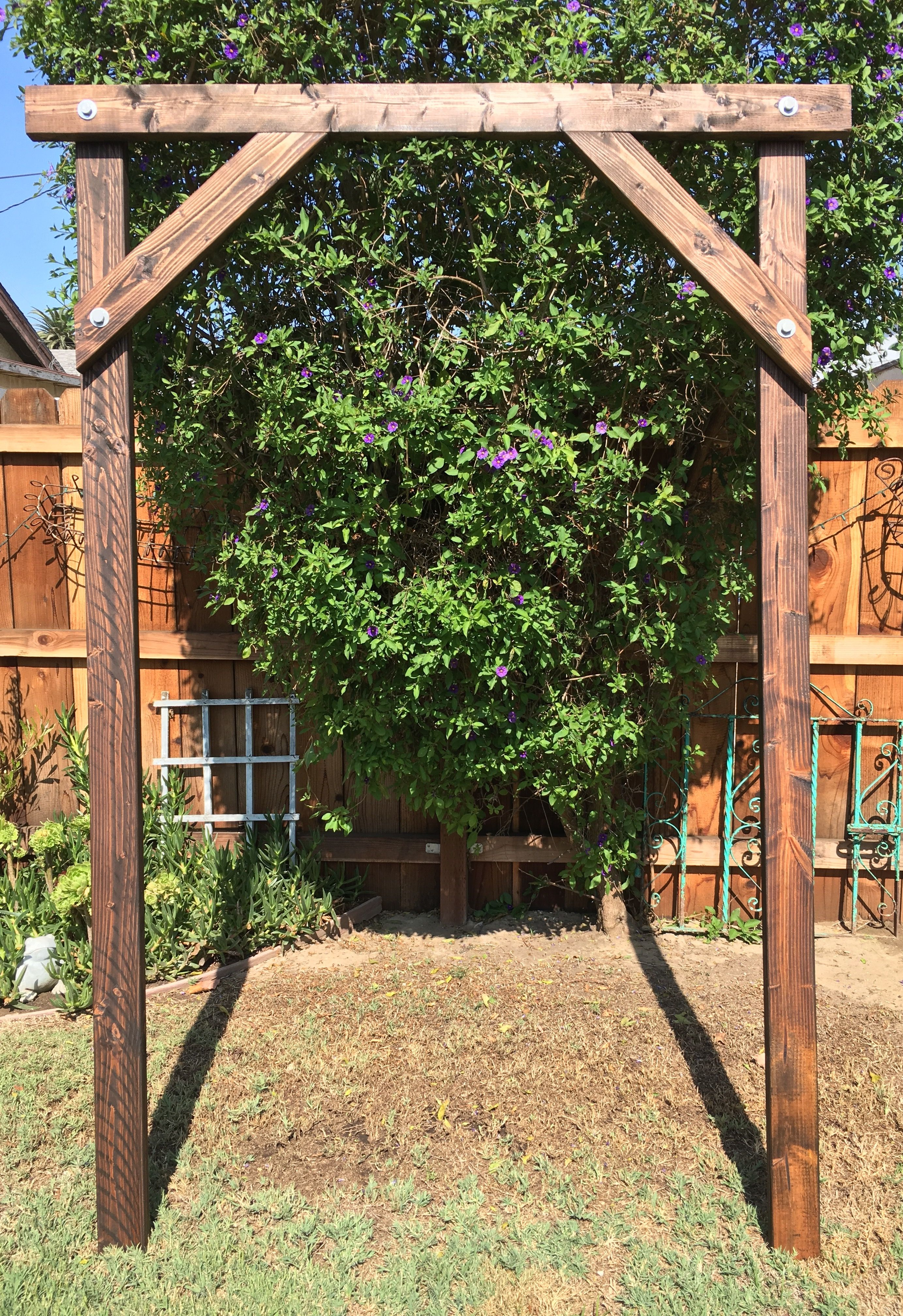 Rustic Wood Arbor Adorn with lights florals and fabric