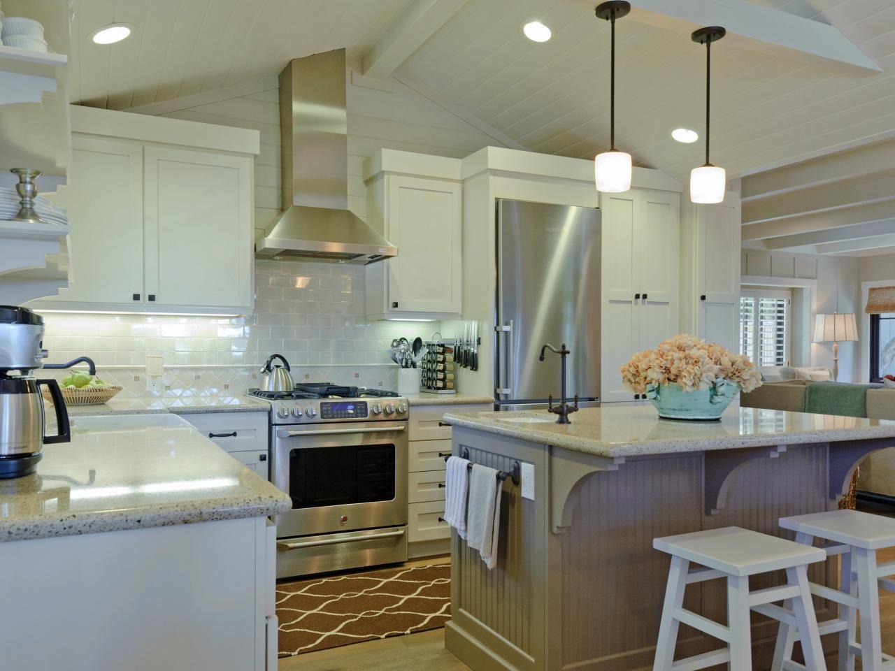 Kitchen Island Centerpiece Two Iron Pendant Lights Hang Above A Kitchen Island Centerpiece In