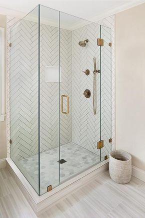 master bathroom shower with white herringbone tiles and