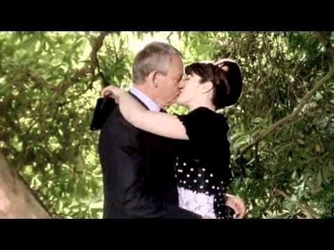 Martin And Louisa Kissing Behind A Tree