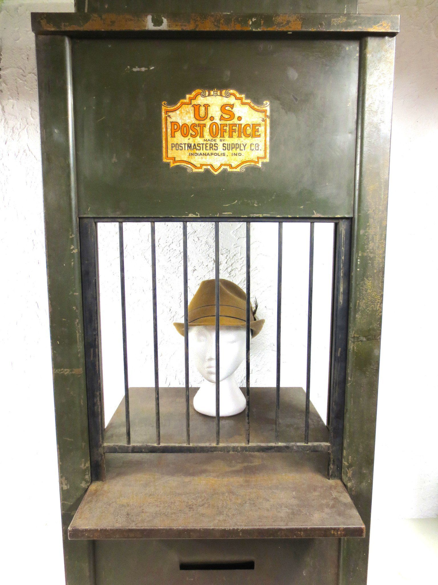 Antique US Post Office Teller Cabinet 46 , Post Office Metal Cabinet, BuiltIn W is part of Metal cabinet Posts - Rare, all original, complete, no broken parts  Measures46  high, 21  wide and 23  deep  Weighs 57 pounds  Original dark green paint  Fully functional cage window and bars, lock, open and close mechanism  3 drawers and 6 mail slots on back  Cabinet is marked U S  Post Office Made by Postmasters Supply Co  Indianapolis,