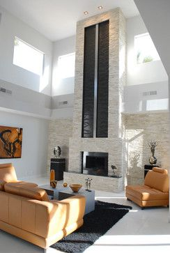 Extended Fireplace Waterfall - modern - living room - las vegas - Earth and Water Studios. I was just about ot comment that the two columns above the fireplace would be a nice water feature. and I see in the notes to the image that they are. brilliant!