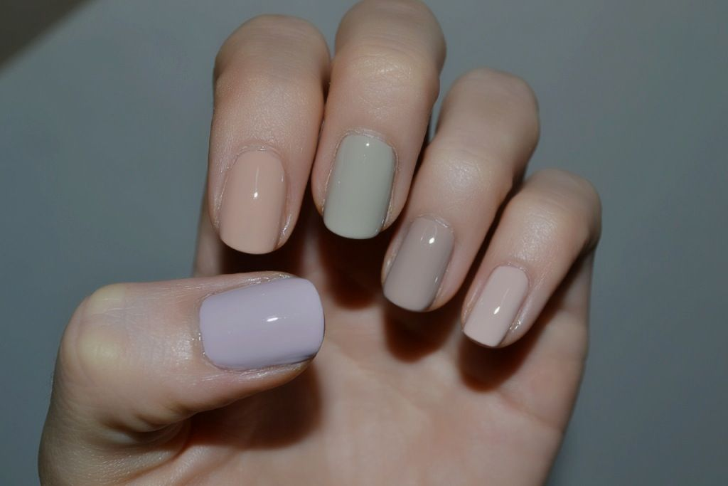 left – right      OPI Steady as She Rose – a beige/grey and subtle lilac     OPI Samoan Sand – a beige with peach tone     Essie Playa del Platinum – a beige/grey     Essie Jazz – a neutral beige with some grey and brown tones     Essie Topless and Barefoot – a beige with some peach/pink tones
