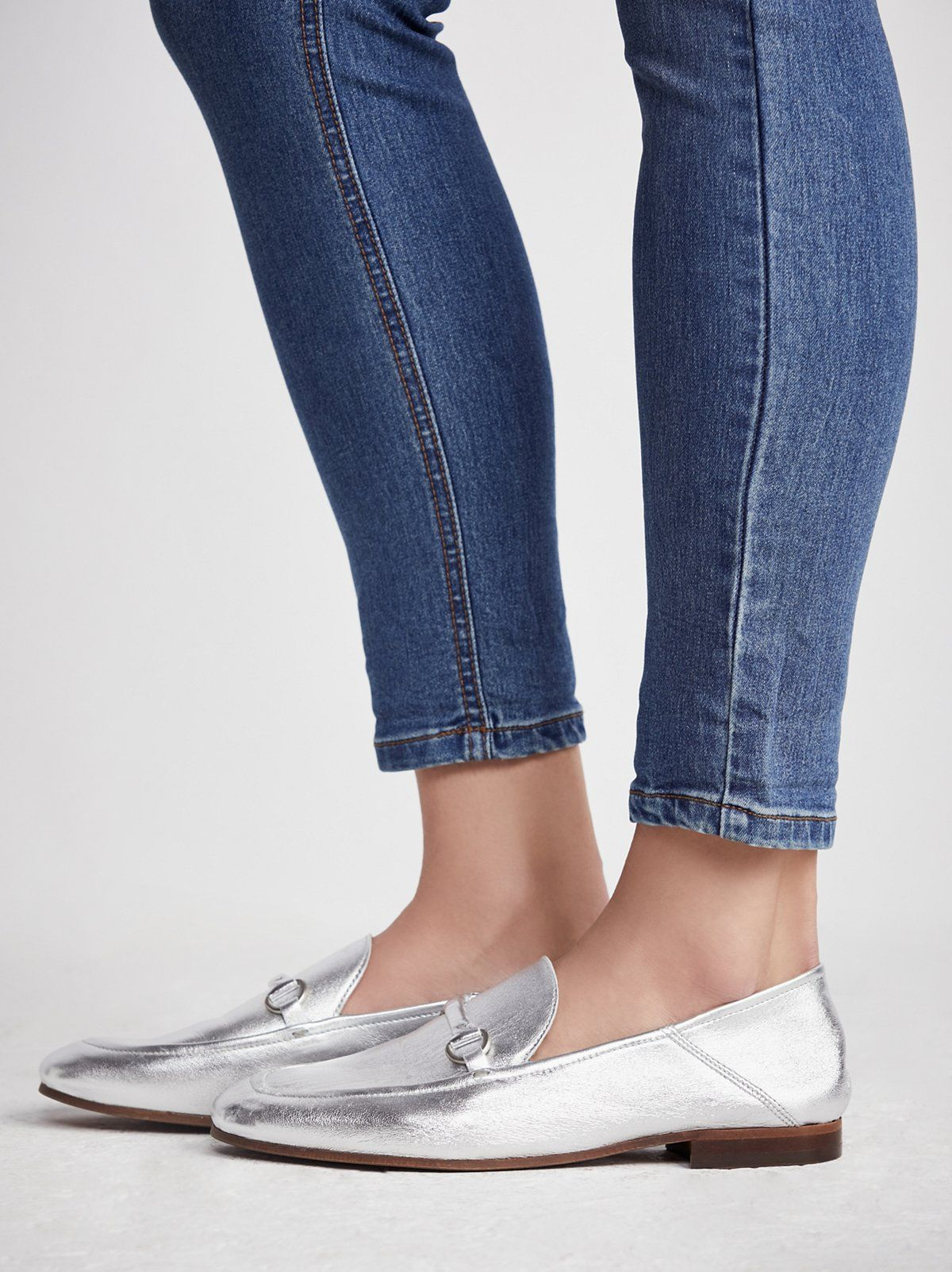 Remington Loafer | Shimmering metallic or femme pink loafer featuring a classic design with a metal chain accent on the top of the foot.