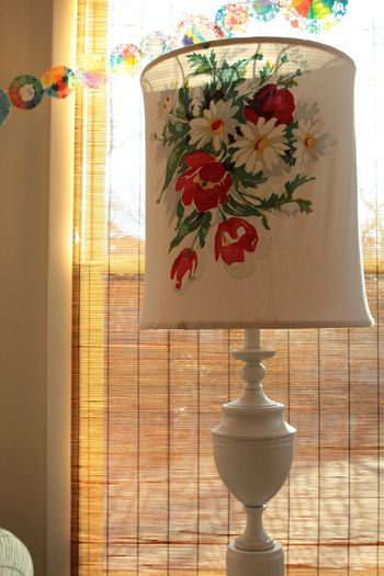 Can you believe this was an ugly cheap old brass lamp!?!?  A coat of paint + vintage tablecloth = fabulous!!
