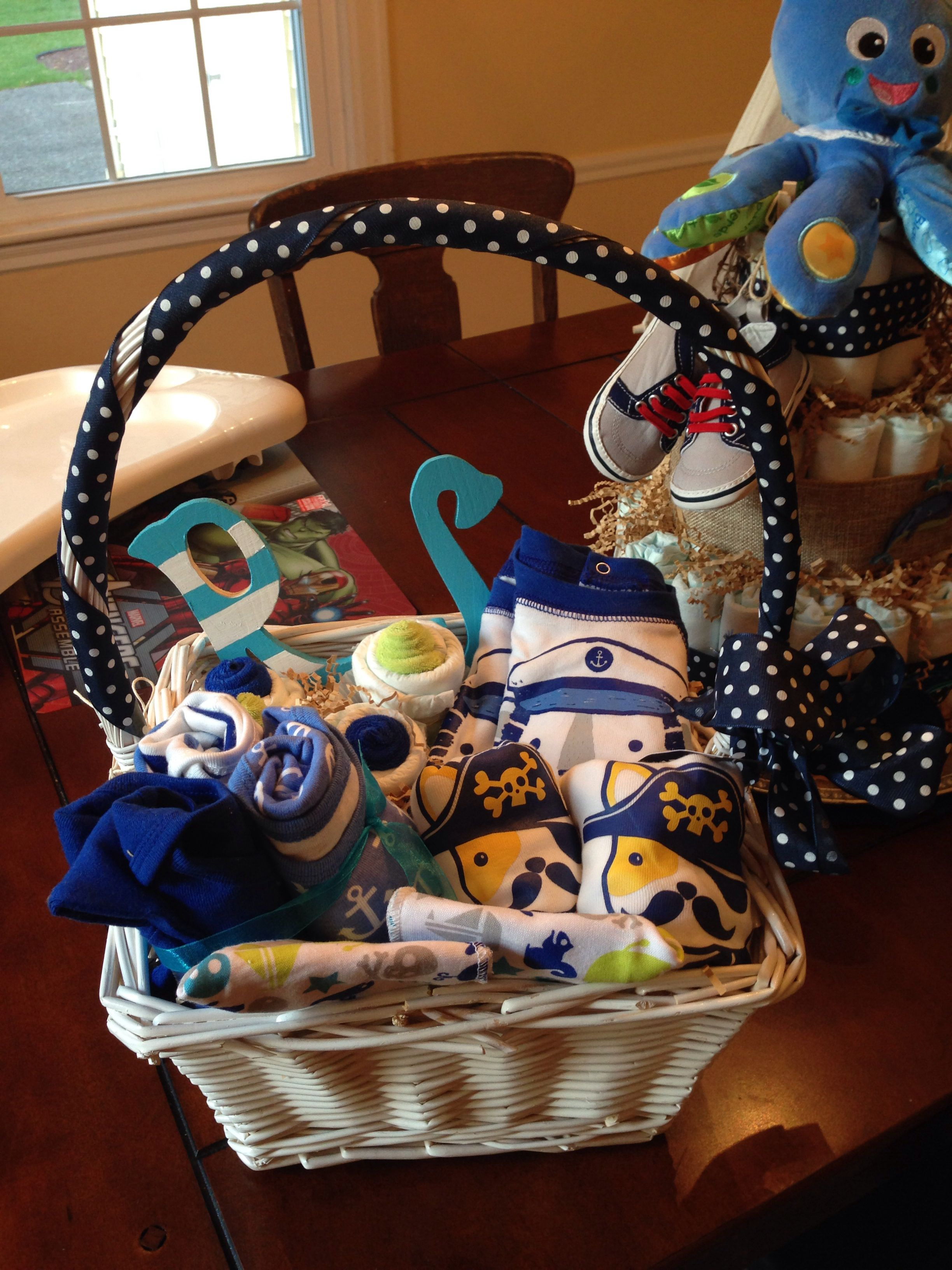 This was a gift basket made by me for a set of twins to match the nautical diaper cake! Yeah for DIY!