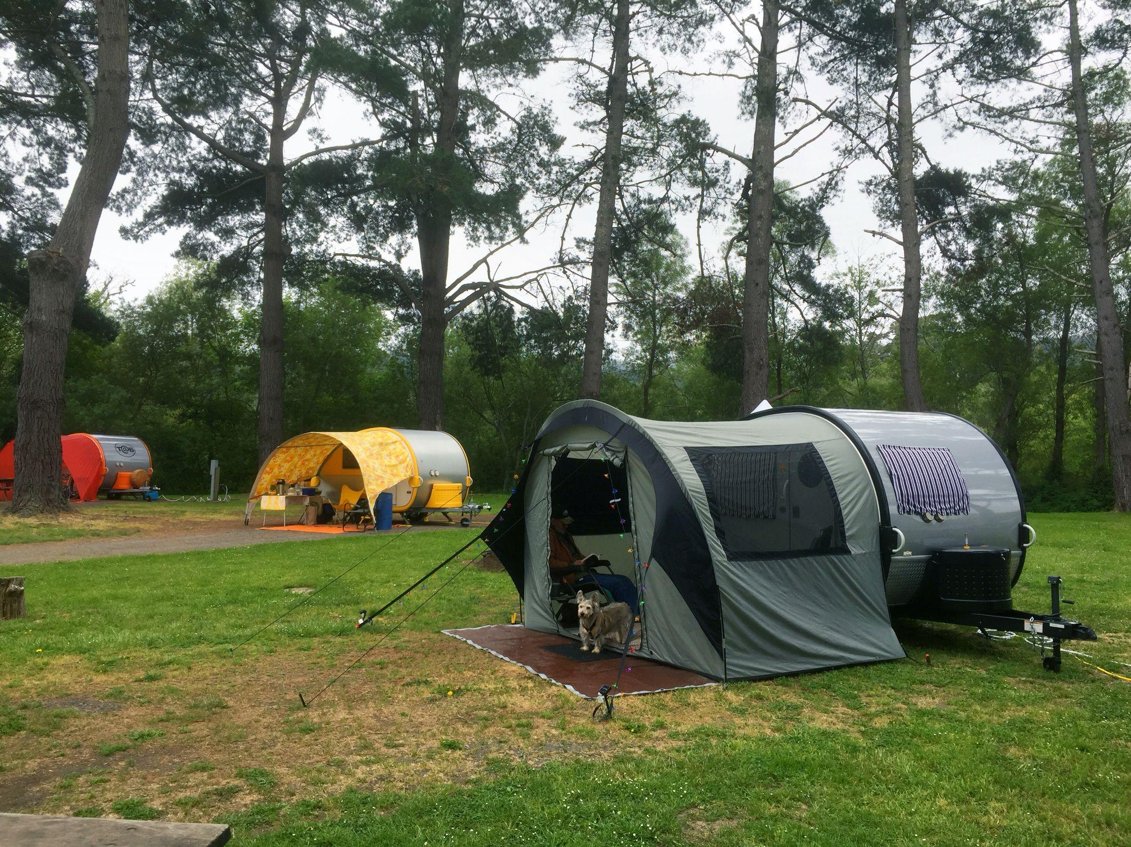 Three in a row Three awnings/tents Photo by Sara Mordecai ...