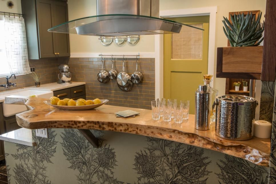 HGTV's Kitchen Cousins Anthony Carrino and John Colaneri create a modern kitchen with a nod to the past as they transform a plain and dated kitchen using luxe and glitzy touches inspired by Hollywood Regency style.