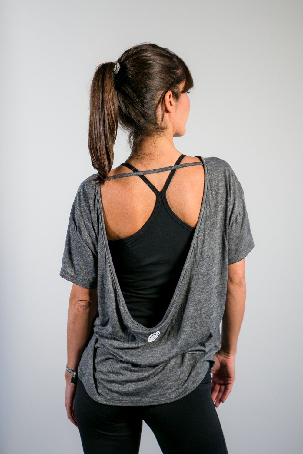 2beef077bc6 This oversized workout tee is a perfectly trendy piece to throw on for your  next Pure Barre class. Our signature pony tee features a high-low hem