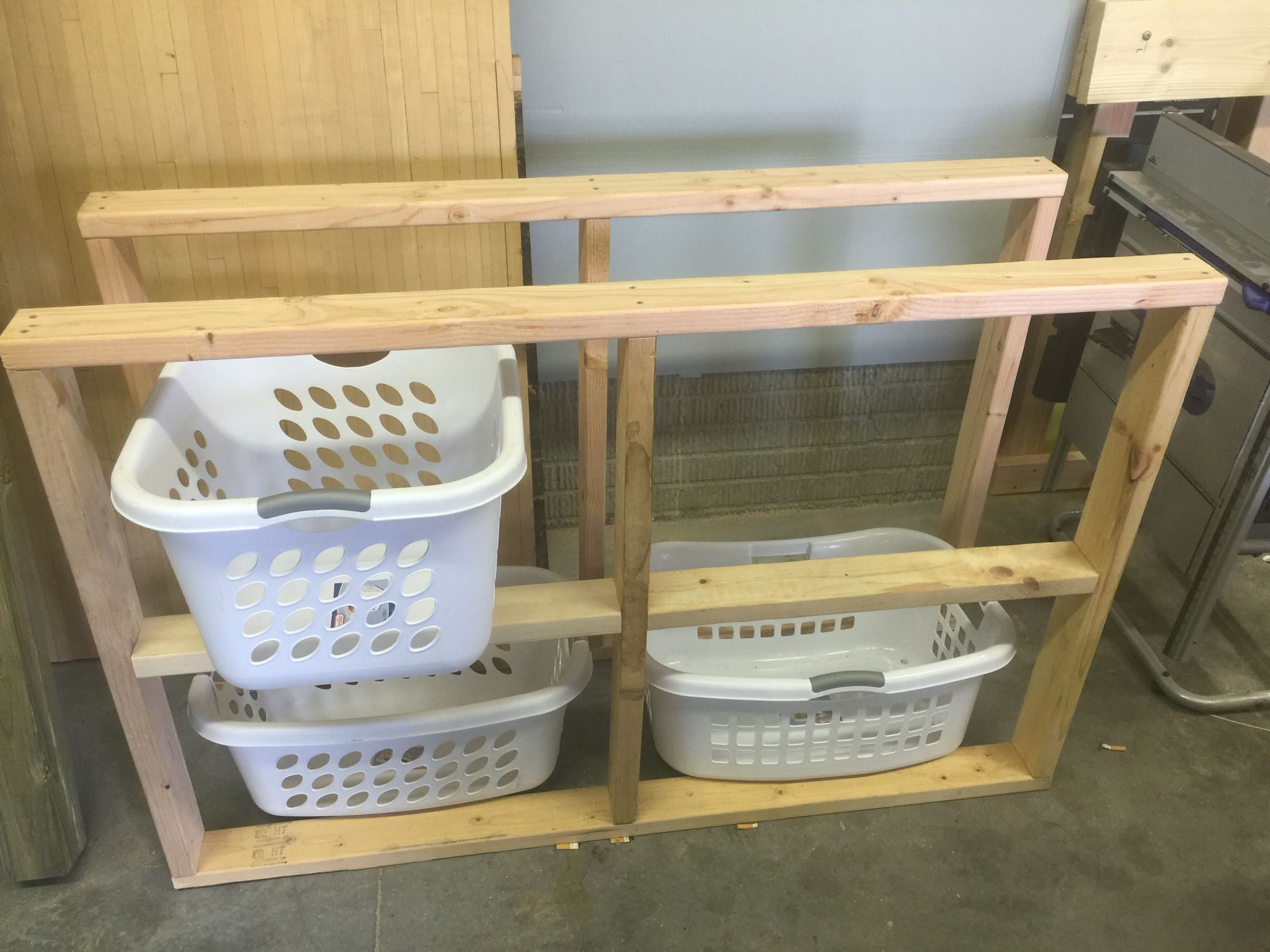Simple 2x4 And Screw Laundry Room Organization Storage Baskets