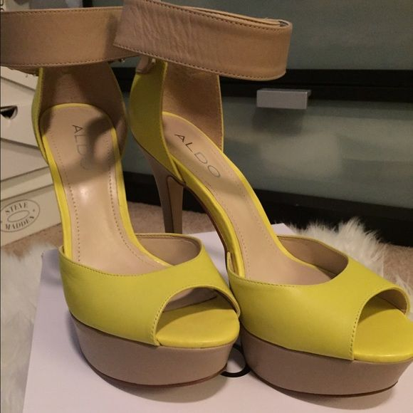 Yellow and nude pumps Yellow and nude open toed pumps, never worn perfect condition just not into this style of shoe anymore. Will to negotiate prices .. Make me an offer! No trades ALDO Shoes