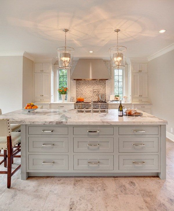 White and gold kitchen features white cabinets adorned with long ...
