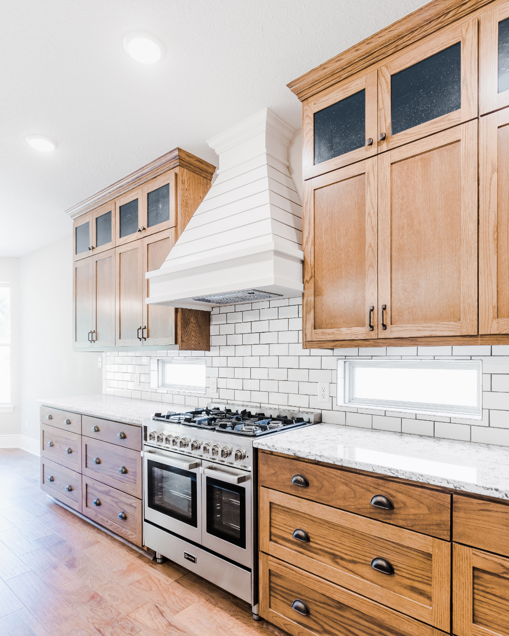 modern farmhouse style kitchen with custom oak cabinets white shiplap hood and white subway on kitchen cabinets farmhouse style id=64272