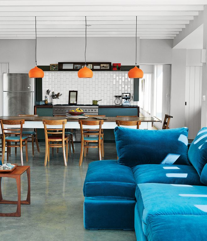 Blue velvet sofa stands out amongst a great kitchen