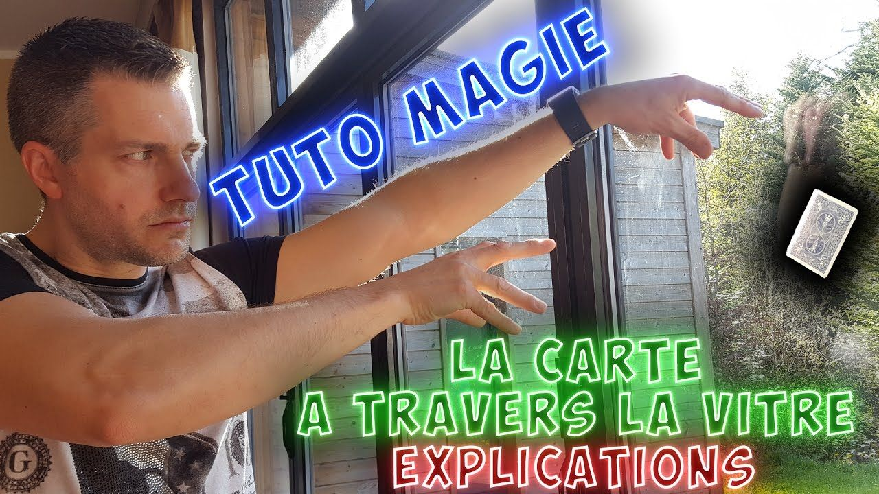 tour de magie carte a travers la vitre