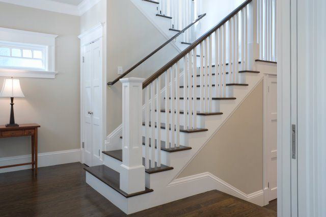 best gray paint colour for dark oak or dark wood flooring and stairs is benjamin moore edgecomb gray. Open staircase.