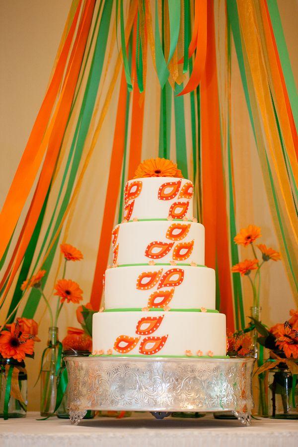An elegant orange and green wedding cake \