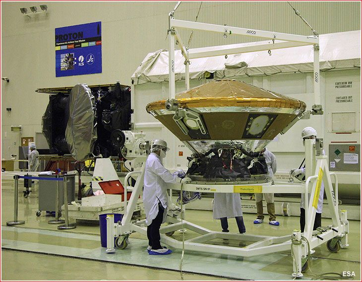 The ExoMars 2016 spacecraft - the Trace Gas Orbiter (in the background) and the Schiaparelli lander (in the center) - in a clean room inside Facility 92A-50 in Baikonur Cosmodrome on Dec. 25, 2015.